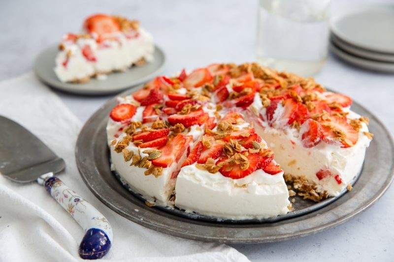 pie topped with fresh strawberries and granola