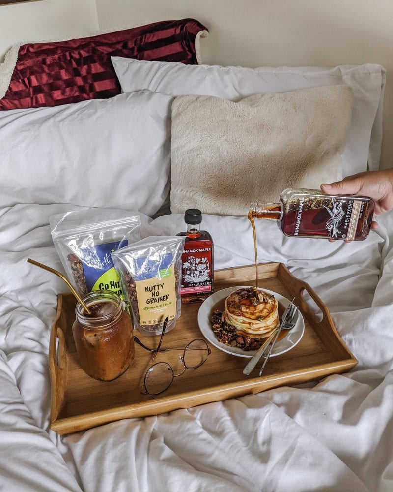 Breakfast tray with pancakes, maple syrup, granola snack packs and Nutty No Grainer