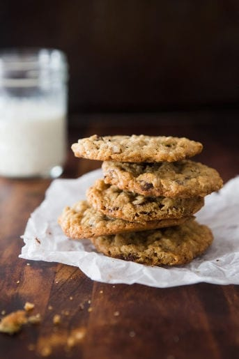 Stack of chocolate-chip granola cookies with milk