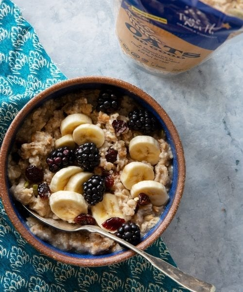 Bowl of GF Oats So Good Muesli topped with fruit and berries